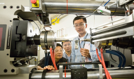 Dr. Dongchul Chae from POSCO, Yuan Li and Peijun Hou from the University of Tennessee, Knoxville, adjust a sample of stainless steel they are studying at VULCAN, SNS beam line 7.